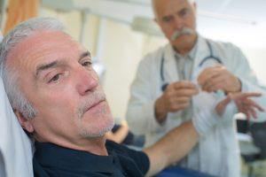 Doctor bandaging a patient