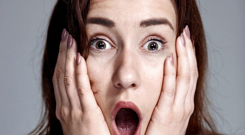 Young woman with shocked facial expression