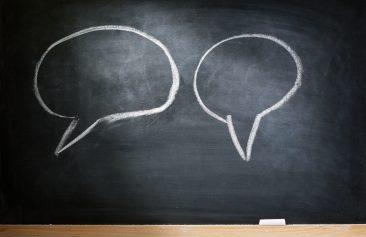 Communication bubbles on chalkboard