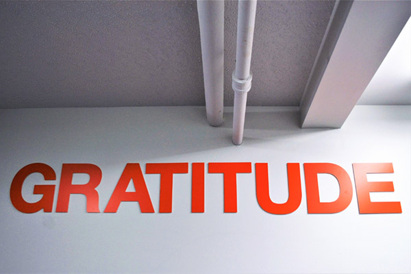 Big orange letters saying gratitude